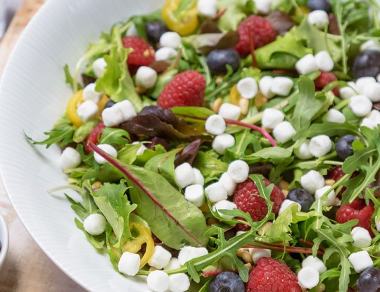 mixed salad with bettine goat cheese balls | raspberries | blueberries | yellow tomatoes | pine nuts