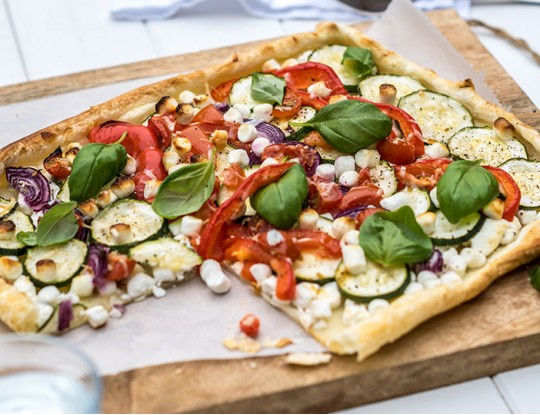 plate pie with fresh goat's cheese and vegetables