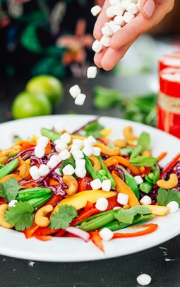 rainbow salad with cashew nuts and goat's cheese
